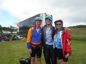 At the finish line in the wet on Sunday with DH and Boy Wonder after riding 591km